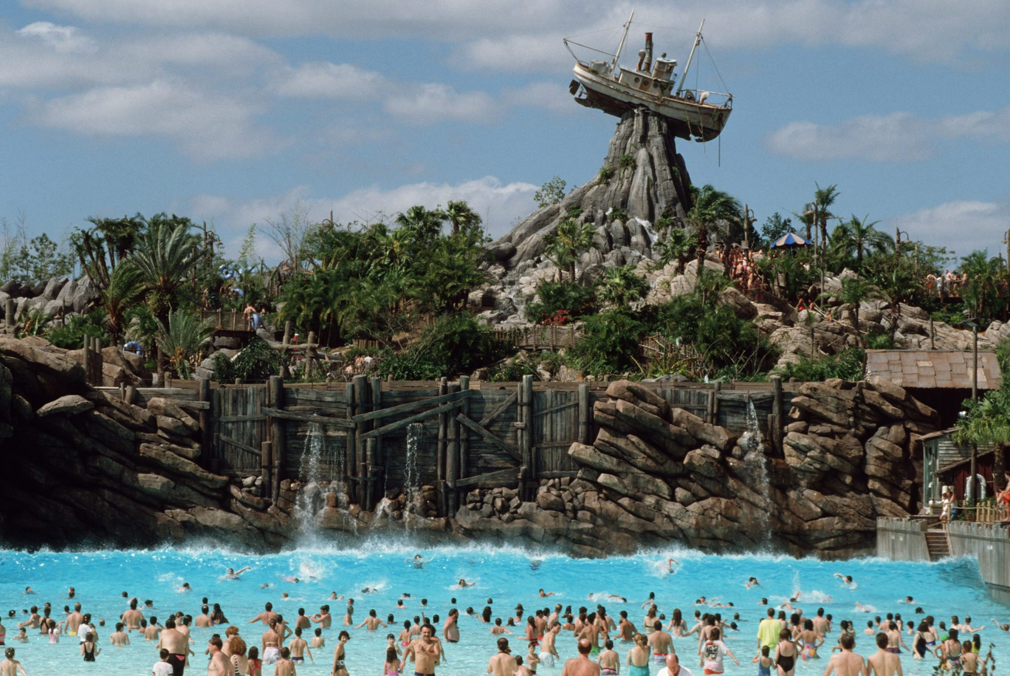 Sunny skies make swimming possible year-round at Typhoon Lagoon at Walt Disney World Resort. The 53-acre themed water park provides plenty of splashing-good fun with water flumes and slides, raft rides, a childrenÕs play area and an inner tube-filled creek that encircles the entire park. (Disney)